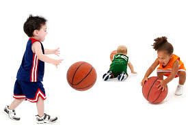 toddlers playing basketball